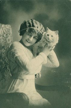 Woman and her white cat, c1910..