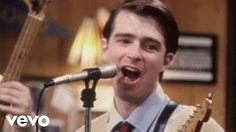 Music video by Weezer performing Buddy Holly. (C) 1994 Geffen Records