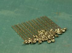 Vintage style gold or silver finish floral bridal hair comb.  The comb has been securely torch soldered, not glued.  About 2 1/4 inches wide.