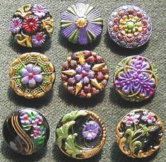 Gorgeous Purple and Green Antique Glass buttons.