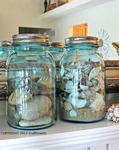 Jars filled with shells and sand on mantel: http://beachblissliving.com/beach-summer-mantel/