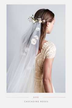 For a more traditional look, Alyssa added cascading ivory and blush-colored flowers to a sparkly comb and circle veil.<br><i> <br> <a href='http://anthrpl.ge/R3lDY' target='_Blank'>Flynn Comb</a> & <a href='http://anthrpl.ge/R3lFC' target='_Blank'>Cirque Veil</a></i>