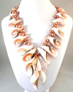 Love these shells mixed with pearls! Ya all know me by now. Love the big statement pieces!