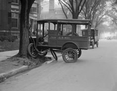 Vintage Auto Accidents in Boston - Mail truck tries to climb tree. Comm. Ave. Boston. by Boston Public Library, via Flickr