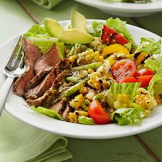 Grilled flank steak makes the perfect topper for this summer-friendly salad. More summer salad recipes: http://www.bhg.com/recipes/salads/ideas/salad-recipes-ideas/?socsrc=bhgpin061014grilledflanksteak&page=11