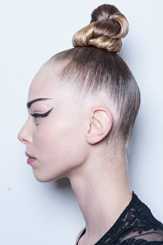Jean Paul Gaultier -An insanely precise, ultra-exaggerated cat eye with a super-sleek, sculptural top knot