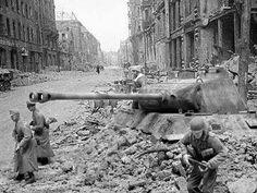 Last battle of the war, Berlin 1945. Using a tank as an artillery piece at an intersection.