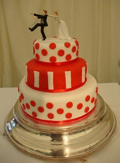 Red and white cake with polka dots and stripes with funky cake topper, don't let that groom get away! This was my wedding cake.