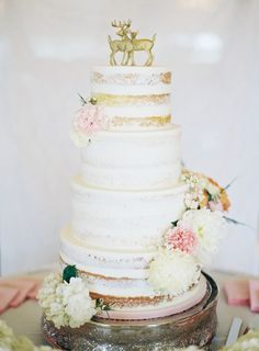 Gold deer figurine topped naked wedding cake: http://www.stylemepretty.com/2015/12/17/whimsical-kansas-city-outdoor-wedding/ | Photography: Brett Heidebrecht - http://brettheidebrecht.com/