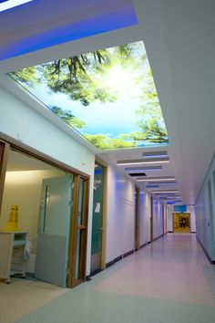A new look for Craigavon Hospital Street with bespoke colour changing LED linear luminaires arranged in a random pattern along the corridor. Printed Barrisol ceilings at intervals indicate the main junctions. An inventive, well received low energy/maintenance solution from MRL Architects and Beattie Flanigan Consulting Engineers