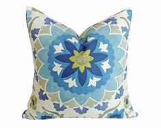 Add some blue and white suzani pillows for coastal styling on that front porch or at the beach house. Interesting large medallions in pretty