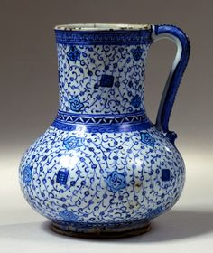 Fritware jug, painted in blue and turquoise under a transparent glaze. 1300-1850