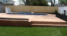 Unique Semi Inground Pools and Their installation : Green Courtyard Brick Textured Deck Inspiring  Semi Inground Pool