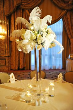 fun centerpiece with feathers!