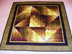 2009.A Jinny Beyer pattern - can you locate the block that's turned wrong?