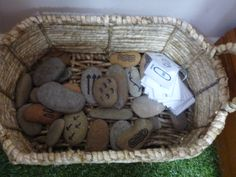 Aboriginal story stones in a basket to create stories by picking out random stones.