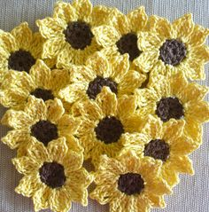 12 brown and yellow cotton thread crochet flowers. Sunflowers? Daisies? Add to scrapbook pages, greeting cards, clothes, crafts, hair clips, picture frames - so many uses.    Each of these small flowers measures approximately 1 1/2 (1.5) inches.  They have 9 pointed petals.    Crocheted in size 10 cotton crochet thread.    Crafted by me in smoke-free & pet-free home.    Carefully shipped in a padded envelope with tracking & delivery confirmation.