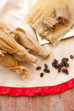 SWEET RAISIN TAMALES (TAMALES DULCES) A tamal, swaddled in a corn husk, is the heart of all things Mexican. Opening one is like opening an intimate secret, a gift.  My grandma not only made her legendary tamales filled with shredded pork simmered in a spicy red chile sauce but she also made tamales dulces (sweet tamales) filled with plump raisins and syrup made from piloncillo (unrefined whole cane sugar) and canela (cinnamon).