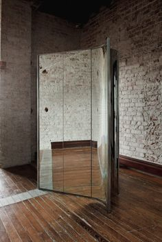 A curving metal streamer, mirrored room screen and bulbous fibre chandelier are among the objects in an exhibition hosted by Masa in Mexico City. Columns Inside, Mirror Room, Wooden Staircases, Room Screen, Studio Room, Architectural Features, Mexico City, Brick Wall, Polished Chrome