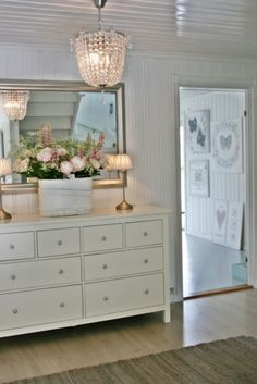 My bedroom bureau with a different mirror…painted…floral arrangement...Lovely white cottage bedroom eclecticallyvintage.com