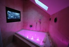 Hot Pink Bathroom, awesome lighting & a flat screen tv.. I would be in here every night!!!