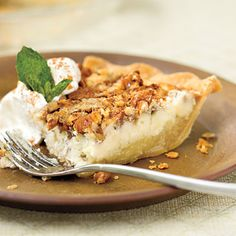 Pecan Cheesecake Pie | Who wants to choose between cheesecake and pie? You can have both with Pecan Cheesecake Pie. This indulgent treat has layers of creamy cheesecake batter, a classic pecan pie filling, and crunchy pecans. | #Thanksgiving Dessert Recipes