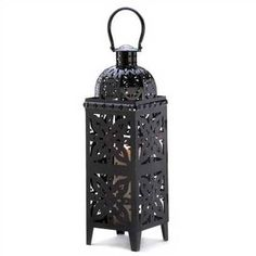 """Impressive in scale and elegant in proportion, this glossy jet-black candle lantern adds drama to any decor, garden or sacred space. An absolute knockout accessory that you won't want to be without! Weight 3 lbs. Candle not included. Iron.    7"""" x 7"""" x 25"""" high."""