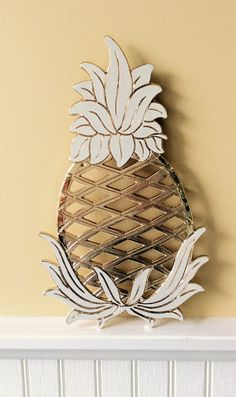 Vintage large gold & white enamel pineapple trivet. Made by Wm. A. Rogers, Oneida, New York. Made in Japan. This is a never used vintage item. Comes with original box & packaging, excellent condition! Great for hostess gift, kitchen decor ( hook on back for hanging), or for anyone who loves to decorate with a coastal, beach theme. Measures 11.75 height x 6.75 wide Thanks for shopping YellowHouseDecor!  Please visit my sisters shop for more vintage items ( ellansrelics02)