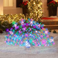 2.5' Tall x 5' Wide Sparkle Snowflakes Christmas Peacock....ok I need this for my Florida home