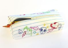 Tutorials | Urban Threads: Craft a fresh start to the school year with a zippered pencil case, stitched like notebook paper and decorated with doodles!