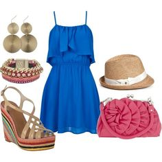 blue skirt/blue tee/ sandals neutral with multi-color stones/ red bracelet and red shoes.