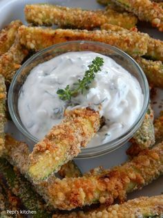 Crispy baked zucchini sticks coated with parmesan cheese and greek yogurt dip made in Pepi's kitchen! Zucchini Sticks, Greek Recipes, Vegan Recipes, Cooking Recipes, Seafood Recipes, Appetizer Recipes, Healthy Snacks, Healthy Eating, Sour Foods