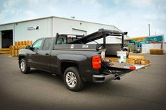2014 Black Chevy Silverado 1500 LT with Leopard Style Pickup Pack™ (hpi black w/ shaved diamonds) with a 4000 lb. Roller Coaster™ Cargo Slide by Highway Products.  Learn more about HPI Pickup Pack™ >>> http://www.highwayproducts.com/product/pickup-packs