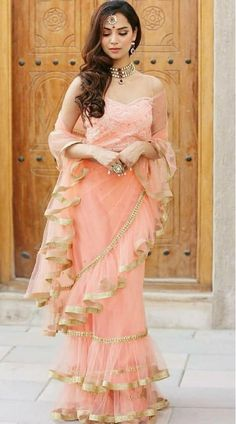 The most trending saree for any occasion is the hassle-free ruffle saree. These ruffle designed sarees are perfect for every occasion and should be just perfect to sort out your wedding season closet. Indian Designer Outfits, Indian Outfits, Designer Dresses, Designer Wear, Mehndi Outfit, Saree Gown, Lace Saree, Lehenga Choli, Indische Sarees