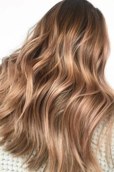Warm Champagne | We love a glass of champagne to celebrate a special occasion (or just weekend brunch), but the bubbly drink is now making its way into salons—in the form of a gorgeous new hair color. Apparently, hair colors inspired by drinks are already a thing, and champagne hair is just the latest pin to tack on to 2018's hair color trends. You might picture champagne hair as simply another blonde but it's much more versatile. It does have a blonde slant, but it can work on light…