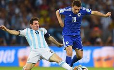Lionel Messi of Argentina challenges Zvjezdan Misimovic of Bosnia and Herzegovina FIFA World Cup 2014