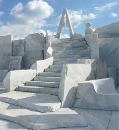"""Stairs made out of marble leading up to the pinnacle of """"The Heights of Eternal Hope for the Future"""" with the abstract """"Tower of the Light"""" marble statue at the top, At Kosanji Temple"""
