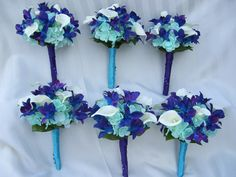 Six Silk Bridesmaids bouquets, blue violet orchids, turquoise hydrangeas and white calla lilies.www.artisticfloraldesign.com