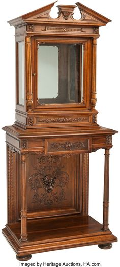 A Renaissance Revival Walnut Vitrine Cabinet And Stand 72 Inches High X  30 1/2 Inches Wide X 19 Inches Deep (182.9 X 77.5 X 48.3 Cm) The Upper  Vitrine ...