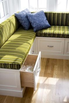 Built-in bench seating along our huge dining table. Cushions upholstered with laminated cotton for wipe-down cleaning. Drawers underneath for table linens, ...
