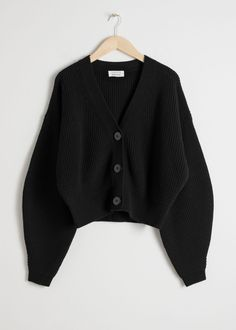 776e4dd6c7f9bb Front image of Stories wool button sweater in black Zwarte Cardigan-outfit