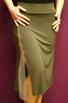 conDiva monochrome jersey skirt with side slit and fishnet details along the slit. A very simple design with a sexy appeal. Available in black, olive green, red.