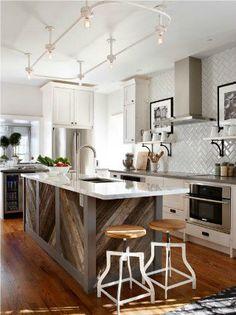 modern farmhouse kitchen. wood chevron island. subway tile. stainless steel