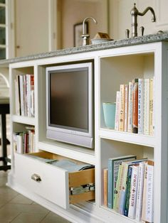 Island Ingenuity ~ 'Island Ingenuity  Add shelves or niches to the end of a cabinet run. The side of an island or cabinet is a prime spot for storing cookbooks and displaying kitchen collectibles.'