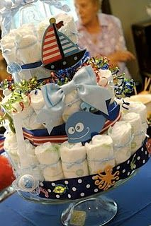 nautical baby boy shower diaper cake. Made it. Very time consuming, but worth it.