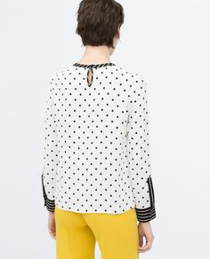 Image 3 of DOTTED TOP WITH CONTRAST CUFF from Zara