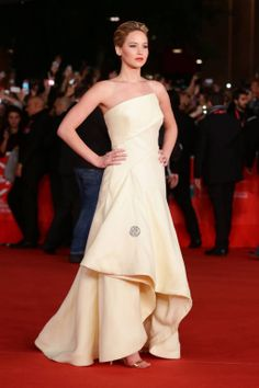 """Jennifer Lawrence's """"Catching Fire"""" Red Carpet Looks"""