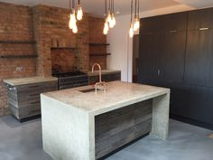 London kitchen project with cast in-situ polished concrete island, reclaimed timber cabinets, hand built copper taps