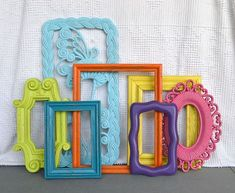 Bright Painted Frames & Mirror Set of 7  Upcycled by BeautiSHE, $58.00    Also a fun way to add a pop of color to a children's bedroom.