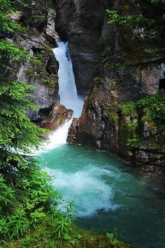 Lower Falls at Johnston Canyon, Banff National Park, Alberta, Canada Few countries can boast of national parks as vast, wild, and stunning as Canada. Banff is just one of many. The Lower Falls in Johnston Canyon is a popular hiking destination, with trails suspended above rushing blue-green whitewater.
